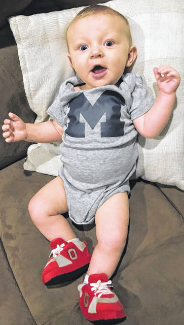 """Of his son Roman Harrington, pictured, father Colt says, """"I'm just hoping that once he gets older I can convince him to come to the OSU side."""" Mother Whitney may have other ideas."""