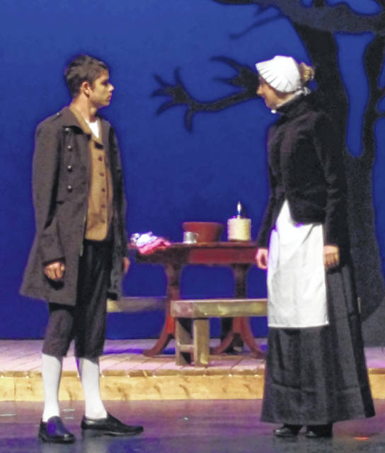 "WHS students Kade Neu and Aubree Trusty rehearse a scene of ""The Crucible."""