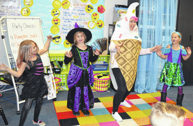 There were harvest parties this week at the Roy E. Holmes Elementary School in Wilmington. Crafts, refreshments, costumes, and dancing were part of the festivities. Dancing in the photo are, from left, Khloe, Lila, teacher Mrs. Shope, and Juliana. For more photos, visit wnewsj.com.