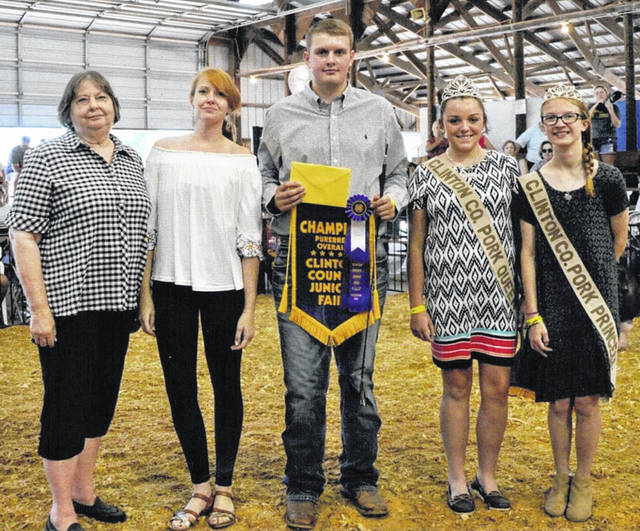 Becky Doak along with daughters Amy Doak and Rachel Doak Swartz presented a special award to this year's Clinton County Junior Fair Purebred Swine Breeding Show winner Jay Schneder. The award was given in memory of the late Ralph Doak, a lifelong resident of Clinton County and a huge supporter of the purebred swine industry and the youth involved not only in Clinton County, but nationally as well. Shown from left are Becky Doak, Amy Doak, Jay Schneder, and Jenna Victor, Clinton County Pork Queen, and Mikala Hatfield, Clinton County Pork Princess. Rachel Doak Swartz is not pictured. (Due to a production error, the News Journal did not run this photo in a more timely fashion. We apologize for that.)