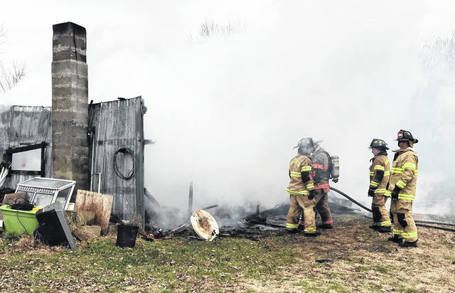 Shown is what remains of a garage that was fully engulfed in flames Wednesday in South Salem. The fire sent a man to the hospital with serious burns.