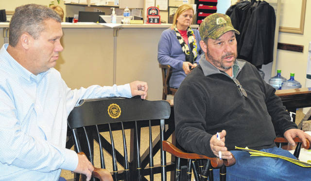 Clinton County Senior Fair Board President Scot Gerber, right foreground, had three ideas for facility improvements at the county fairgrounds when he met with the county commissioners. Commissioner-elect Mike McCarty, left foreground, and Clinton County Administrator Mary Ann Haines Foland, right background, were also part of his audience.