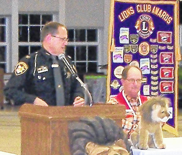 Clinton County Sheriff's Chief Deputy Brian Prickett spoke at the Wilmington Lions Club meeting on Monday. He offered advice and tips to help ensure members' personal safety, and how to protect ourselves from theft and fraud. He shared some personal experiences and described some examples of recent victims and how they were tricked into sending large amounts of money because of being scammed. The presentation was very informational and greatly appreciated by those in attendance. Shown are Prickett and seated Club President John Hibbs.