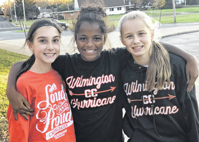 "Helping out at the ""Girls on the Run"" practice 5K run were Wilmington Middle School cross-country runners Addy Smith, Taliah Billingsley and Sophie Huffman, pictured. They joined the event in order to be running buddies for the elementary-level girls who comprise the ""Girls on the Run"" team. ""We had cross-country members and cheerleaders present to help,"" said team coach Brandy Smith."