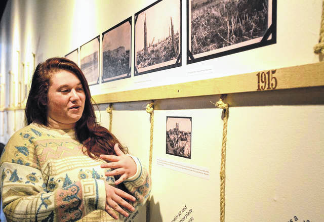 Sophomore Mikaela Prescott describes events on the World War I timeline. She and nine other students helped produce the exhibit, which opens Sunday evening.