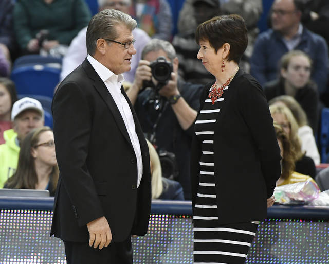 FILE - In this Dec. 3, 2017, file photo, Connecticut head coach Geno Auriemma, left, talks with Notre Dame head coach Muffet McGraw before an NCAA college basketball game in Hartford, Conn. Even as Pat Summitt and Tennessee were playing the main foil to Auriemma's Huskies in the late 1990s and early 2000s, McGraw's Irish were right there too, playing memorable games with their former Big East rival. (AP Photo/Jessica Hill, File)