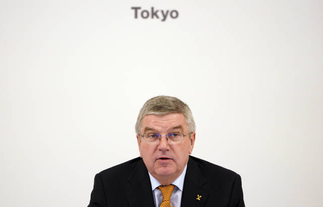 International Olympic Committee (IOC) President Thomas Bach attends an IOC Executive Board meeting Saturday, Dec. 1, 2018, in Tokyo. The IOC said boxing will take place at the 2020 Tokyo Olympics. But exactly who runs the tournament and the details of qualifying are up in the air because of charges of corruption and malfeasance surrounding the boxing federation that runs the sport at the Olympics. (AP Photo/Eugene Hoshiko)