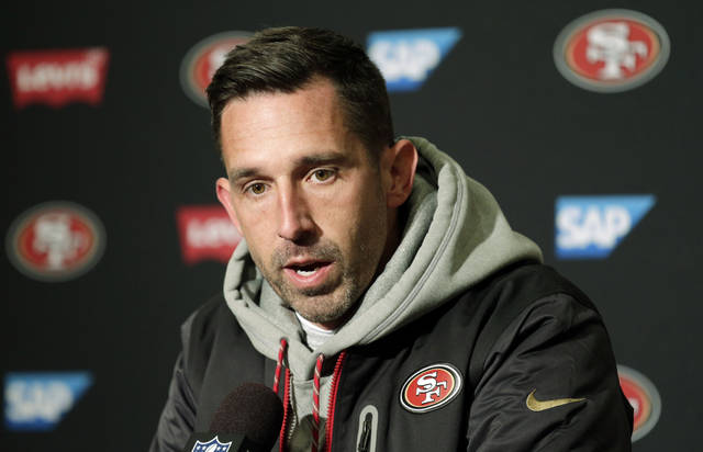 FILE- In this Sunday, Dec. 2, 2018, file photo, San Francisco 49ers head coach Kyle Shanahan talks to reporters following an NFL football game against the Seattle Seahawks in Seattle. The Seahawks won 43-16. Shanahan has started his first two seasons with the team with a 2-10 record. (AP Photo/John Froschauer, File)