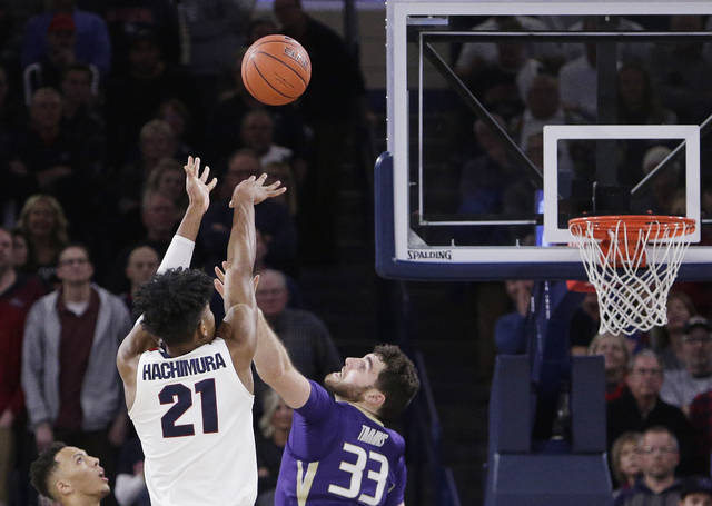 Gonzaga forward Rui Hachimura (21) shoots the go-ahead basket while defended by Washington forward Sam Timmins (33) during the second half of an NCAA college basketball game in Spokane, Wash., Wednesday, Dec. 5, 2018. Gonzaga won 81-79. (AP Photo/Young Kwak)