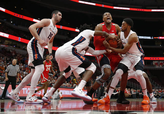 Ohio State forward Kaleb Wesson, center, battles Illinois guard Ayo Dosunmu, left, and guard Alan Griffin, right, for the ball as Illinois forward Giorgi Bezhanishvili (15) looks on during the first half of an NCAA college basketball game Wednesday, Dec. 5, 2018, in Chicago. (AP Photo/Jeff Haynes)