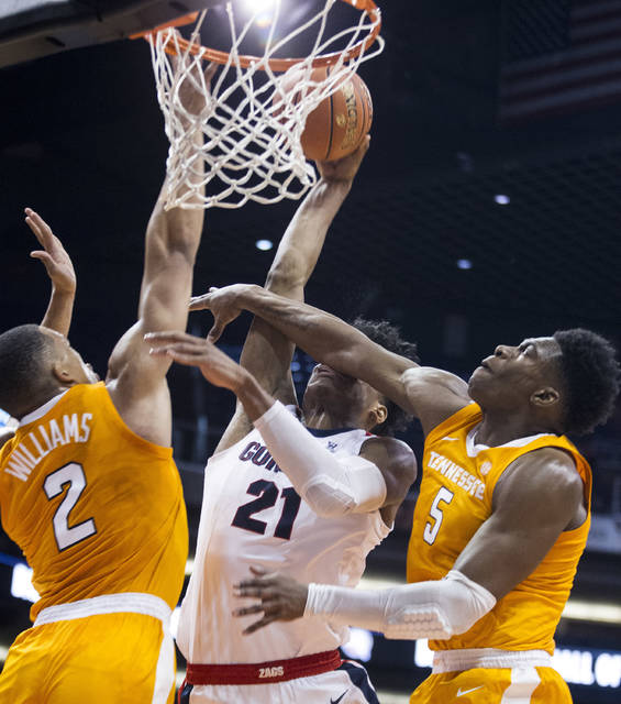 Gonzaga's Rui Hachimura (21) is fouled by Tennessee's Admiral Schofield (5) and Grant Williams (2) during the first half of an NCAA college basketball game Sunday, Dec. 9, 2018, in Phoenix. (AP Photo/Darryl Webb)