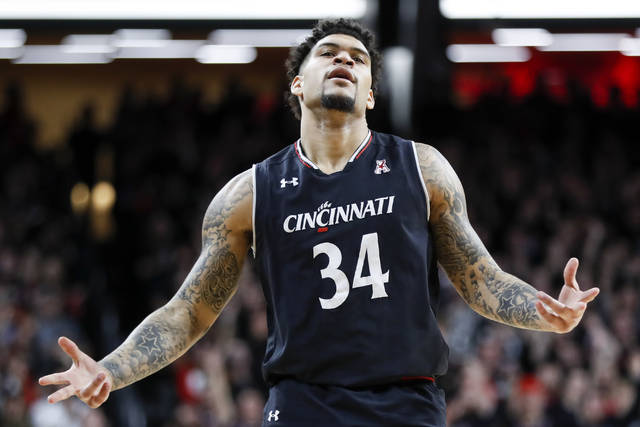 Cincinnati's Jarron Cumberland reacts after scoring during the first half of an NCAA college basketball game against UCLA, Wednesday, Dec. 19, 2018, in Cincinnati. (AP Photo/John Minchillo)