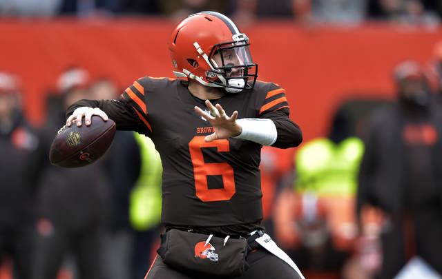 Cleveland Browns quarterback Baker Mayfield throws during the first half of an NFL football game against the Cincinnati Bengals, Sunday, Dec. 23, 2018, in Cleveland. (AP Photo/David Richard)