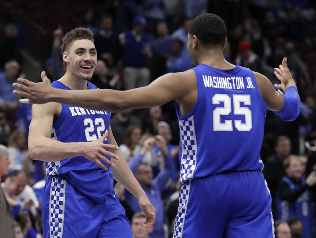 Kentucky forward Reid Travis, left, celebrates with forward PJ Washington Jr., after their team defeated North Carolina in an NCAA college basketball game in the fifth annual CBS Sports Classic, Saturday, Dec. 22, 2018, in Chicago. (AP Photo/Nam Y. Huh)