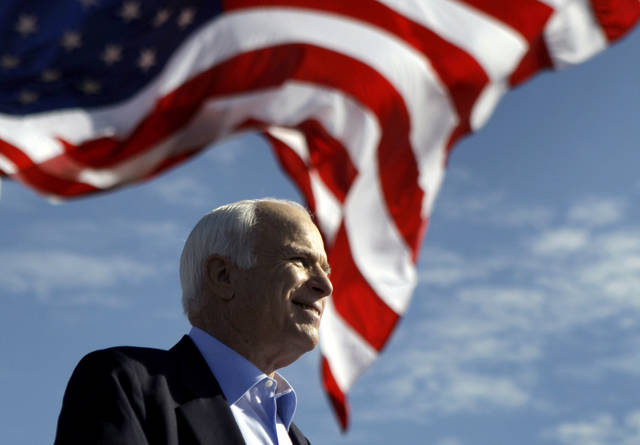 FILE - In this Nov. 3, 2008, file photo, Republican presidential candidate Sen. John McCain, R-Ariz., speaks at a rally in Tampa, Fla. Aide says senator, war hero and GOP presidential candidate McCain died Saturday, Aug. 25, 2018. He was 81. (AP Photo/Carolyn Kaster, File)