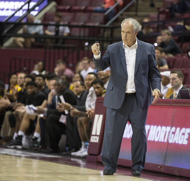 File-This Dec. 21, 2017, file photo shows  Southern Miss head coach Doc Sadler pumping his fist after a score in the first half of an NCAA college basketball game against Florida State in Tallahassee, Fla. Frustrated mid-major conference officials are taking drastic action they hope will nudge the selection pendulum in their direction when it comes to NCAA Tournament at-large invitations and seeding. Leading the way is Conference USA, which has dumped a conventional league schedule in favor of a revolutionary one based on results. C-USA's 14 teams won't know who they'll be playing during the final two weeks of the regular season until mid-February, when the standings will determine the final matchups. The move is to ensure the league's best teams are playing each other in hopes of improving their tournament profiles. (AP Photo/Mark Wallheiser, File)