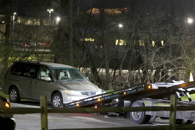 "FILE - In this April 10, 2018 file photo, a minivan is removed from the parking lot near the Seven Hills School campus in Cincinnati. The desperate last words of a 16-year-old boy who told a 911 operator ""I'm going to die here"" continue to hang over Cincinnati, eight months after the death of Kyle Plush on April 10 after he was trapped in the family minivan. This was one of Ohio's top stories of 2018. (Cara Owsley/The Cincinnati Enquirer via AP, File)"