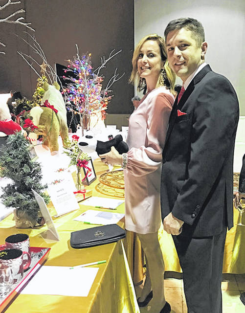 Clinton Memorial Hospital's Chief Executive Officer Lance Beus and his wife enjoy looking over the many auction items.