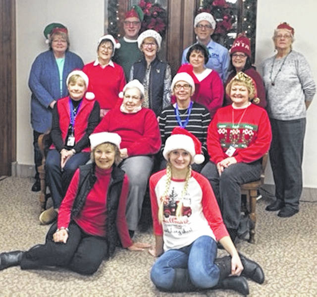 "Clinton County CASA volunteers met for their monthly ""CASA Coffee"", a monthly in-service training and peer networking opportunity for those serving as volunteer child advocates. The volunteers donned Santa hats and posed for a photo at the courthouse. The volunteers pictured are Beverly Drapalik, Tarah Mongold, Barb Glass, Kenna Edwards, Lorry Swindler, Laura McGuire, Diana Groves, Judy Johnston, CASA Director Kim Vandervort, Kathy Vincent, Deb Moore, Jeff Drapalik, Kent Vandervort and Sandy Bigley. Not pictured are volunteers Tonia Farley, Elizabeth Biggane, Angela Mitchell-Koster and Mary Conger. For information on the CASA volunteer program, please call 937-383-1137."