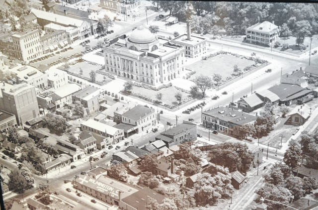 "In this bird's-eye view of Wilmington, note that the ""Washington Oak"" which was recently damaged during the ice storm stands not-so-tall at the northwest corner of the courthouse square. Note also that the post office (now the Clinton County Prosecutor's Office) is under construction in the top middle/left of the photo, meaning the photo was taken around 1929. This photo is courtesy of Greg Hart, whose father-in-law, Bill Vandervort, was a mail carrier."