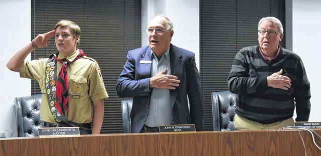 From left, Star Scout Joe Daugherty joins Wilmington Mayor John Stanforth and Council President Mark McKay in the Pledge of Allegiance during Thursdays' city council meeting.