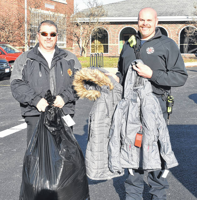 Wilmington Fire Chief Andy Mason, left, and firefighter Jack Coates made their yearly stops at all the Wilmington elementary schools Wednesday to deliver the new winter jackets they got through fundraising in their Coats for Kids. The fundraiser is meant to help children in need of new winter coats.