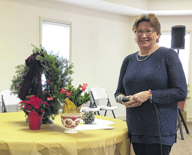 Jean Singleton presented a program on Christmas flowers, symbols and legends.