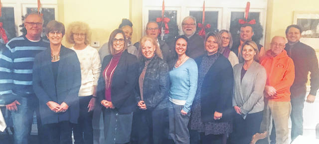 From left are: Front row, Karen Carter, Mindy McCarty-Stewart, Joni Straber, Erin Moore, Chastity Flanigan, Andrea Bush and Steve Haines; and, back row, Gary Downing, Vicki Wilson, Amber Hollins, John Quallen, Wynn Alexander, Fayanne Saunders, Curt Bradshaw and Brian Shidaker.