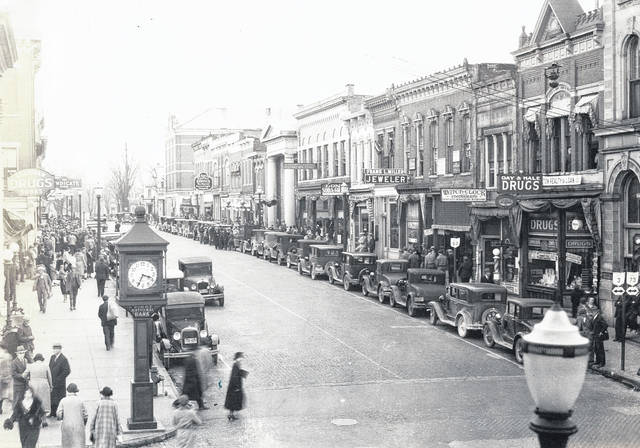 "Downtown Wilmington was a busy place when this undated photo was taken; could it be the 1930s? From the right foreground, businesses include Day & Hale Drugs, Wilmington Realty & Loan, ""Watch-Clock-Phonograph"", Frank L. Miller Jeweler, Long Soda-Grill, and on down the line is DP&L. At left are Grantham Drugs-Sodas and The Syndicate Store."