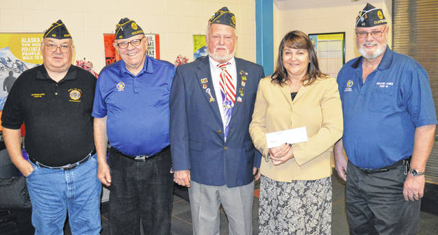 The American Legion Post 49 in Wilmington donated $3,000 to go toward laptops in Wilmington City Schools (WCS). The funds will go into the technology fund at the high school. The American Legion heard about a need and chose to help fill it, said WHS intervention specialist Tracy Dyer. From left are Charles Rose, Bob Baker, Jim Cook, WCS Treasurer Kim DeWeese accepting the donation, and Richard James.