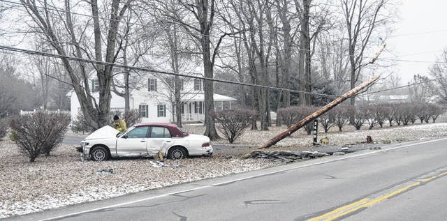 Wilmington Fire Department and police personnel responded to a single-car accident involving a Mercury sedan that snapped a utility pole on Wayne Road just before 10 a.m. Monday. The road was closed at SR 73 and Mitchell due to low hanging wires. The driver was transported with what were believed to be non life-threatening injuries.
