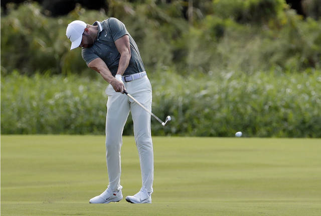 Woodland leads Tournament of Champions, McIlroy three back