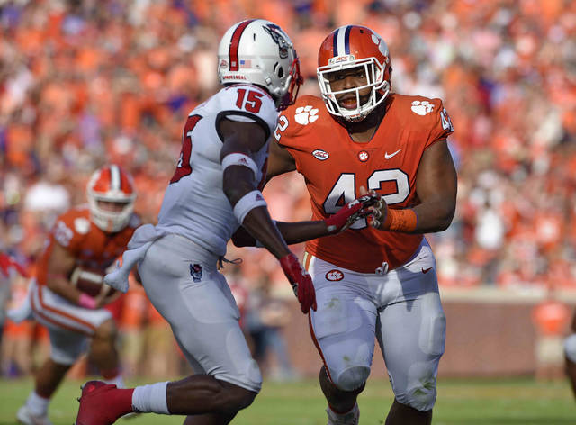 FILE - In this Oct. 20, 2018, file photo, Clemson's Christian Wilkins (42) works against North Carolina State's Chris Ingram during the first half of an NCAA college football game in Clemson, S.C. There are few one-on-one matchups where Alabama is ever going to be a disadvantage against Clemson. Clemson's defensive line might be good enough to capitalize on some small vulnerability even without suspended 340-pound run stuffer Dexter Lawrence. Tigers All-America defensive tackle Wilkins against Alabama left guard Lester Cotton is a place where the Tigers can win one-on-one. (AP Photo/Richard Shiro, File)