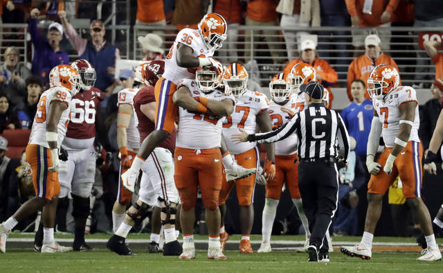 The Clemson defense celebrates after stopping Alabama during the second half of the NCAA college football playoff championship game, Monday, Jan. 7, 2019, in Santa Clara, Calif. (AP Photo/Chris Carlson)