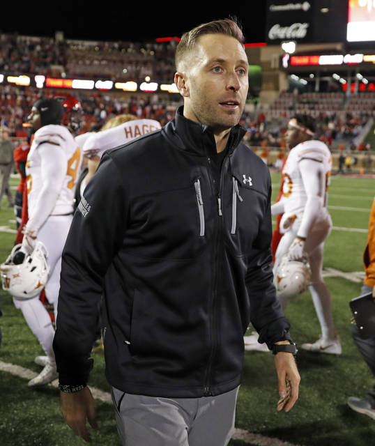 FILE - In this Nov. 10, 2018 file photo Texas Tech coach Kliff Kingsbury walks off the field after the team's NCAA college football game against Texas in Lubbock, Texas. The Arizona Cardinals have hired Kingsbury, a move aimed at providing guidance for young quarterback Josh Rosen and resuscitating the worst offense in the NFL. The Cardinals announced the hiring Tuesday, Jan. 8, 2018 after a long interview earlier in the day. (AP Photo/Brad Tollefson, file)