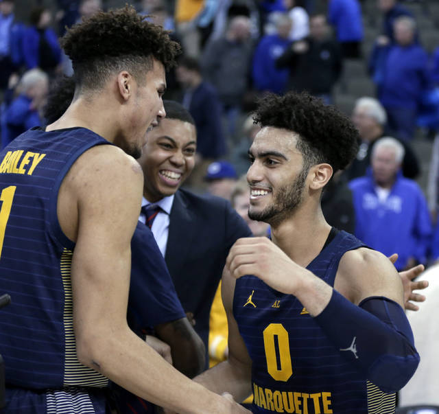 Marquette's Markus Howard, right, celebrates with Brendan Bailey (1) following the team's NCAA college basketball game against Creighton in Omaha, Neb., Wednesday, Jan. 9, 2019. Howard scored 53 points as Marquette won 106-104 in overtime. (AP Photo/Nati Harnik)