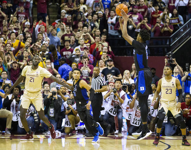 Duke forward Cam Reddish takes the game-winning shot against Florida State with less than a second left in an NCAA college basketball game in Tallahassee, Fla., Saturday, Jan. 12, 2019. Duke defeated Florida State 80-78. (AP Photo/Mark Wallheiser)