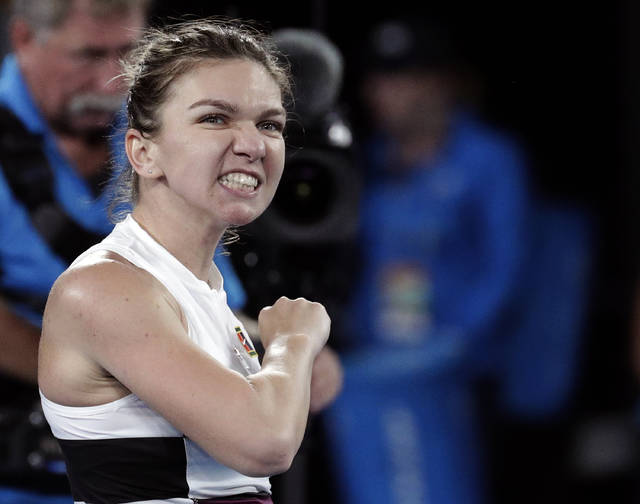 Romania's Simona Halep celebrates after defeating United States' Sofia Kenin in their second round match at the Australian Open tennis championships in Melbourne, Australia, Thursday, Jan. 17, 2019. (AP Photo/Aaron Favila)