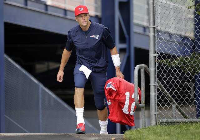 "FILE - In this Aug. 3, 2017, file photo, New England Patriots quarterback Tom Brady steps on the field at NFL football training camp in Foxborough, Mass. From the first day of training camp in August until deep into the NFL schedule, you hear it. Doesn't matter what city a team represents or who is coaching and playing for it, the bromide is the same. Win the division. ""I certainly don't take it for granted,"" says Brady, who's taken the Patriots to eight Super Bowls, with five wins _ all after winning the AFC East. (AP Photo/Steven Senne, File)"
