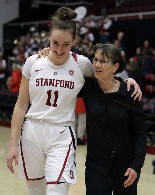 Stanford coach Tara VanDerveer, right, walks off the court after an NCAA college basketball game with Alanna Smith (11) after her 900th win at Stanford, defeating Washington State Sunday, Jan. 20, 2019, in Stanford, Calif. (AP Photo/Ben Margot)