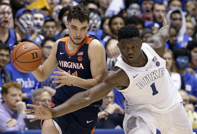 Duke's Zion Williamson (1) tries to steal the ball from Virginia's Ty Jerome during the second half of an NCAA college basketball game in Durham, N.C., Saturday, Jan. 19, 2019. Duke won 72-70. (AP Photo/Gerry Broome)