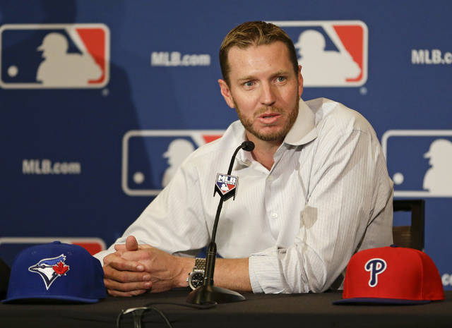 FILE - In this Dec. 9, 2013, file photo, two-time Cy Young Award winner Roy Halladay answers questions after announcing his retirement after 16 seasons in the major leagues with Toronto and Philadelphia at the MLB winter meetings in Lake Buena Vista, Fla. Halladay, Mariano Rivera and Edgar Martinez seem likely to be elected to baseball's Hall of Fame on Tuesday, Jan. 22, 2019. ( AP Photo/John Raoux, File)