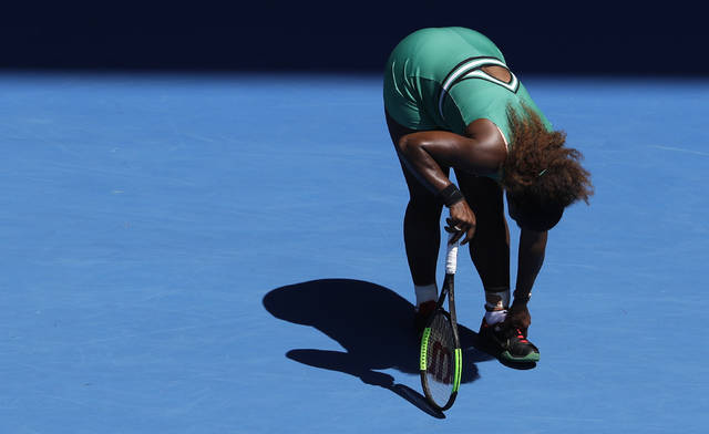 United States' Serena Williams grabs at her ankle during her quarterfinal loss to Karolina Pliskova of the Czech Republic at the Australian Open tennis championships in Melbourne, Australia, Wednesday, Jan. 23, 2019. (AP Photo/Mark Schiefelbein)