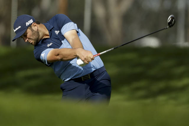 Jon Rahm, of Spain, hits from the fairway on the ninth hole during the first round of the Farmers Insurance Open golf tournament on the North Course at Torrey Pines Golf Course on Thursday, Jan. 24, 2019, in San Diego. (AP Photo/Chris Carlson)