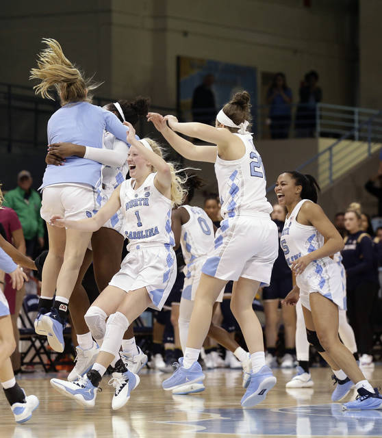 North Carolina players celebrate their 78-73 win over Notre Dame in an NCAA college basketball game in Chapel Hill, N.C., Sunday, Jan. 27, 2019. (AP Photo/Gerry Broome)