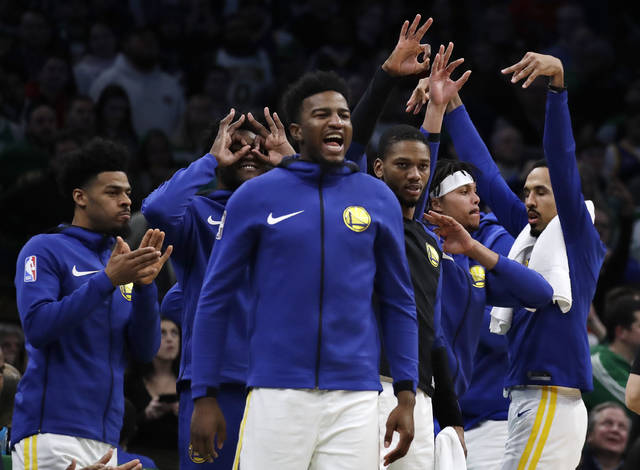 Golden State Warriors bench players celebrate late in the fourth quarter of an NBA basketball game against the Boston Celtics, Saturday, Jan. 26, 2019, in Boston. (AP Photo/Elise Amendola)