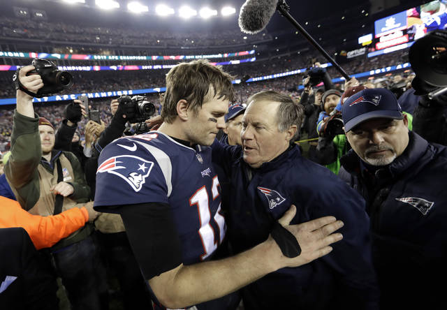 FILE - In this Jan. 21, 2018, file photo, New England Patriots quarterback Tom Brady, left, hugs coach Bill Belichick after the AFC championship NFL football game against the Jacksonville Jaguars in Foxborough, Mass. New England's five Super Bowl champions turned over an average of 19.2 players the season after they won their titles. Brady and Belichick have been the constant. (AP Photo/David J. Phillip, File)