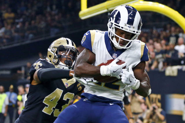 FILE - In this Nov. 4, 2018, file photo, Los Angeles Rams wide receiver Brandin Cooks (12) pulls in a touchdown reception in front of New Orleans Saints free safety Marcus Williams (43) in the first half of an NFL football game in New Orleans. Cooks is the first player in NFL history to have three consecutive 1,000-yard receiving seasons with three different teams.  (AP Photo/Butch Dill, File)