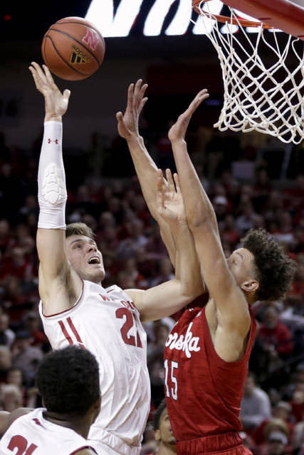Wisconsin's Ethan Happ (22) goes for a layup against Nebraska's Isaiah Roby (15) during the first half of an NCAA college basketball game in Lincoln, Neb., Tuesday, Jan. 29, 2019. (AP Photo/Nati Harnik)