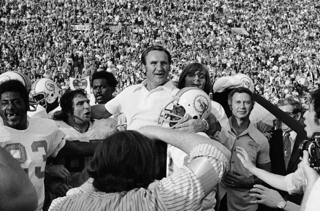 FILE - In this Jan. 14, 1973 file photo, Miami Dolphins coach Don Shula is carried off the field after his team won NFL football Super Bowl game with a 14-7 victory over Washington Redskins in Los Angeles. Yes, it's time for another story about the Patriots trying to accomplish something nobody has done since the '72 Dolphins. But not THAT story. Eleven seasons after falling one win short of matching Miami's perfection, New England is trying to become the first team since those famed Dolphins to follow a loss in the Super Bowl with a title the very next year. (AP Photo/File)